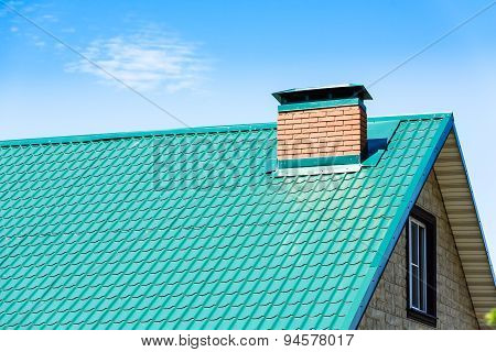 chimney on the roof of the house against the blue sky poster