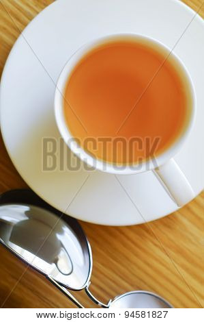 Cup Of Tea And Sun Glasses.