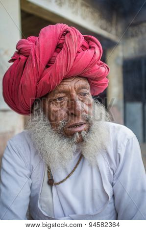 GODWAR REGION, INDIA - 12 FEBRUARY 2015: Elderly Rabari tribesman with traditional turban, clothes and long beard. Rabari or Rewari are an Indian community in the state of Gujarat.