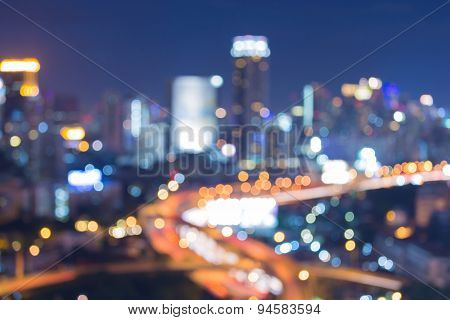 Abstract blur bokeh lights big city highway during blur hour
