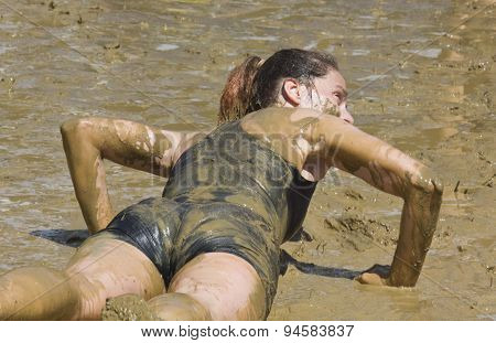 A Woman Lie Down In The Mud