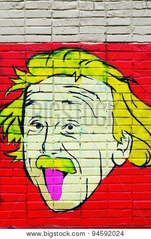 Portrait of Einstein on the wall.
