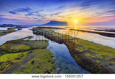 Sunrise at Seongsan Ilchulbong, Jeju island, South Korea.