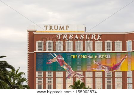 Las Vegas USA - October 28 2016: Trump International hotel marquee positioned behind the Treasure Island hotel as seen from the Vegas Strip in Las Vegas NV. The signage aligns to create a humorous message about Donald Trump's treasure.