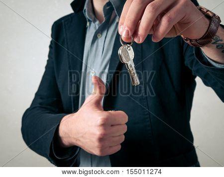 Man close up giving the new keys