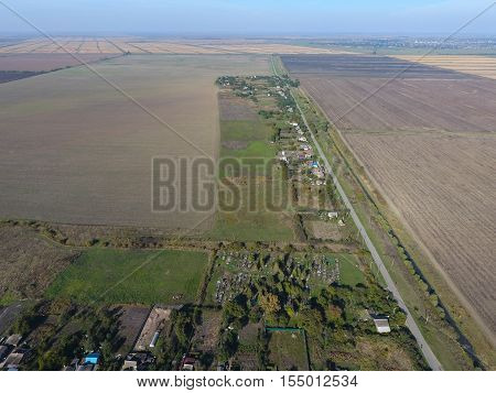 Top View Of The Village. One Can See The Roofs Of The Houses And Gardens. Road In The Village. Villa