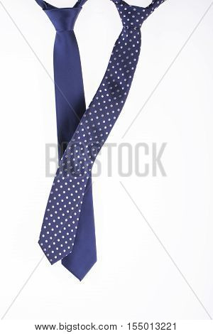 two blue tie with tied knots on the white background