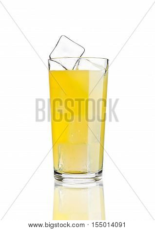 Glass of orange soda drink cold with ice cubes on white background with reflection
