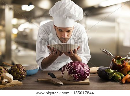 Chef smelling the aroma of a dish at the restaurant kitchen