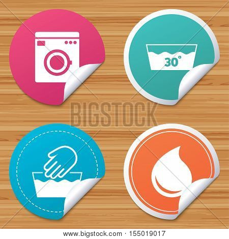 Round stickers or website banners. Hand wash icon. Machine washable at 30 degrees symbols. Laundry washhouse and water drop signs. Circle badges with bended corner. Vector