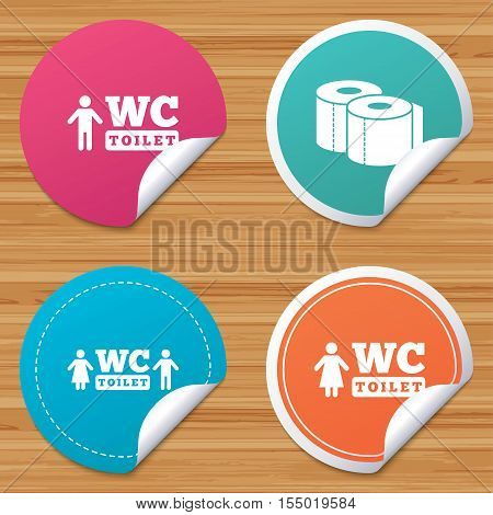Round stickers or website banners. Toilet paper icons. Gents and ladies room signs. Man and woman symbols. Circle badges with bended corner. Vector