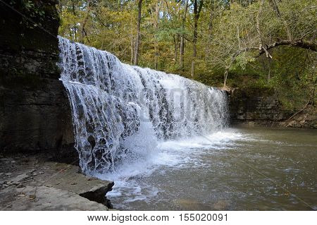 A waterfall in the park during summer
