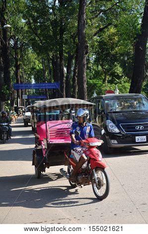 Man Drives On Tuk Tuk At Cambodia