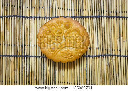 Mid-Autumn Festival moon cake on wooden traditional mat