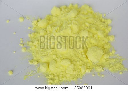 sulfur powder batch on the white paper