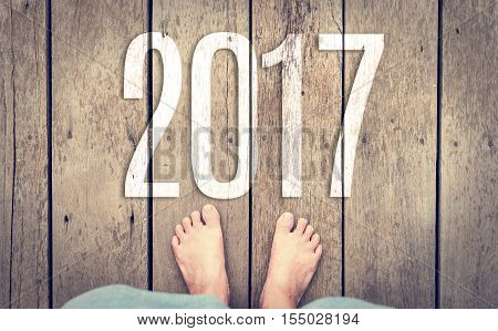 Aerial View Of Barefoot With Short Pants Stand On Grunge Wood Plank Floor With White 2017 New Year N