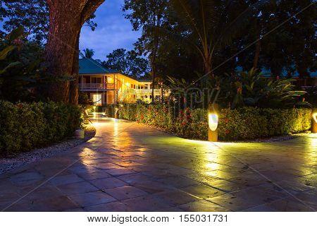 Tambor Costa Rica - June 22: evening view of the lit path to the hotel rooms. June 22 2016 Tambor Costa Rica.