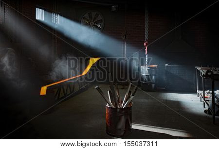 Blacksmith workshop interior with light rays coming from windows