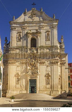 Martina Franca, Apulia. The facade of St. Martin's Basilica at the Piazza Plebiscito, Taranto province, Apulia in South Italy.