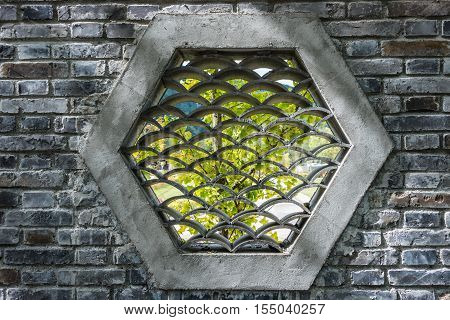 trational brick window in chinese garden,wall patterned background.