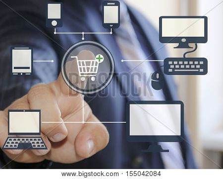 Shopping. Businessman clicking the shopping cart on the touch screen.Online payment purchase.