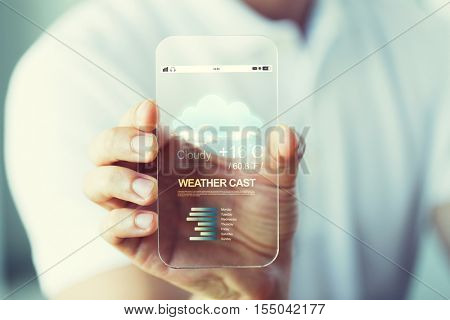 business, technology, weather cast and people concept - close up of male hand holding and showing transparent smartphone with meteo forecast