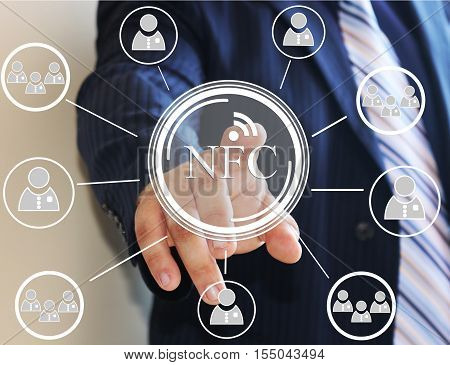 The businessman taps the NFC icon on the touch screen. NFC near field communication, network. Web icons.
