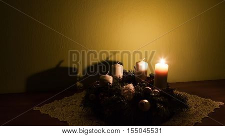 Homemade advent wreath with one burning candle