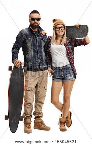 Full length portrait of male skater with a longboard and a female skater with a skateboard isolated on white background
