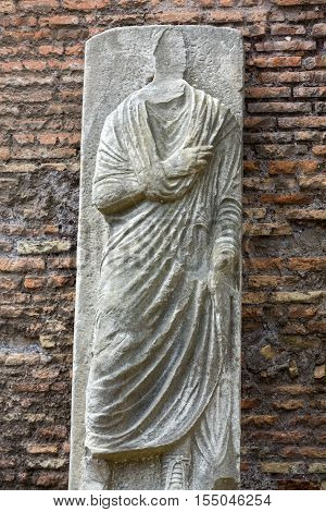 The ancient statue in the baths of Diocletian (Thermae Diocletiani) in Rome. Italy