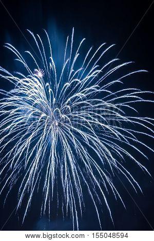 White fireworks during the celebrations on black background