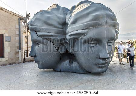 People Admire Mucem Sculpture, Three Heads Sculpture At Fort St Jean
