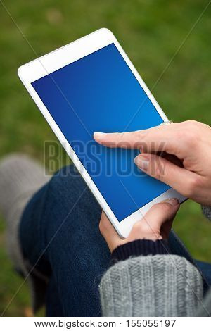 Woman Using Tablet With Finger