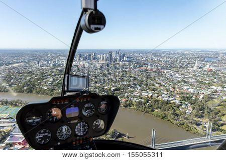 On-board a helicopter with Brisbane cityscape in horizon