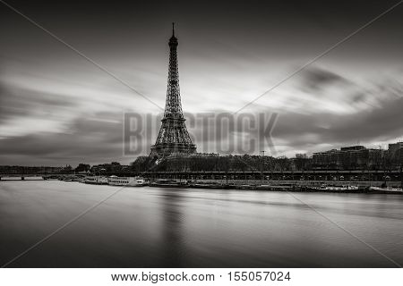 Sunrise on the Eiffel Tower and Seine River in winter in Black & White. Port de Suffren, Grenelle, 15th and 7th Arrondissements of Paris, France