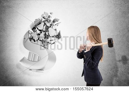 Blond woman with sledgehammer is crashing 3d dollar sign made of concrete. Concept of communist oppression