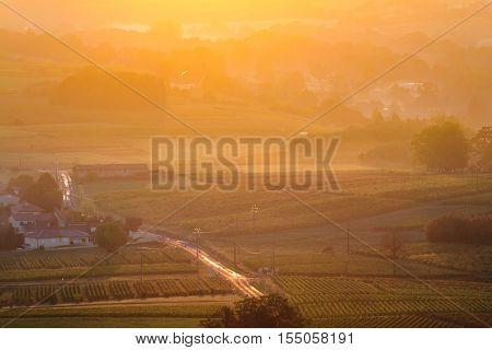 Sunrise Over Vineyards Of Beaujolais During Autumn Season