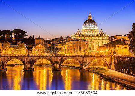 San Pietro Basilica and Ponte St Angelo at twilight. Rome Italy