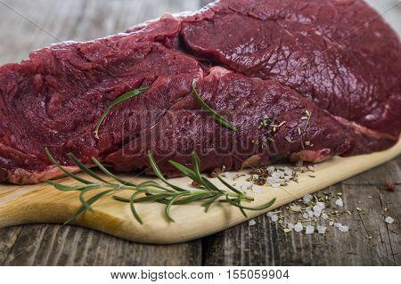 Beef Steak On Wooden Board.