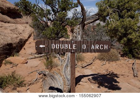 Arches National Park Utah USA - September 02 2016: Double O Arch sign post at Arches National Park in Utah