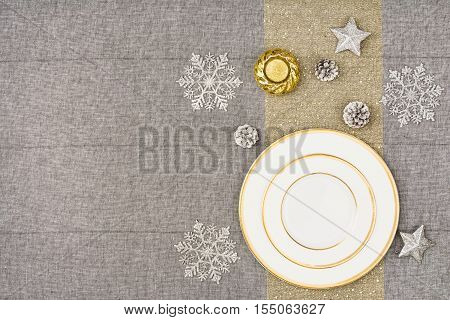 Christmas table seen from above, top view. Linen, vintage background with visible texture. Mock up with a lot of copy space for text or graphical elements.