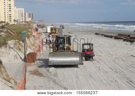 JACKSONVILLE EACH, FL - OCTOBER 29, 2016: Beach renourishment project underway in Jacksonville Beach. The project cost is over $13.5 million and 61% is funded federally.