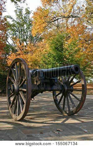 a Civil War cannon with autumn foliage in the background, on Lookout Mountain, Tennessee