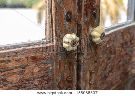 Classic door handle on wooden door - Stock Photo