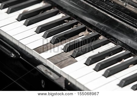 Close-up broken piano keyboard - stock photo