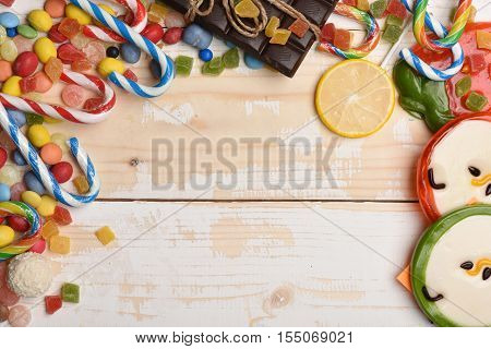 Vintage Wooden Background With Colorful Dragee