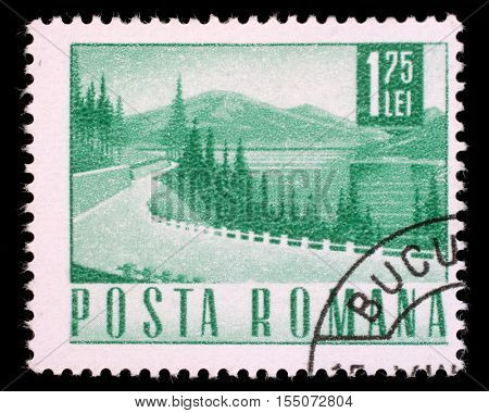 ZAGREB, CROATIA - JULY 19: A stamp printed in Romania showing a Lakeside highway, circa 1967, on July 19, 2012, Zagreb, Croatia