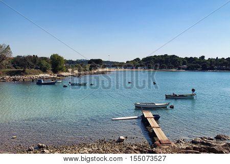 Pula Croatia - September 29 2016: Fishing boats in the bay of Stoja