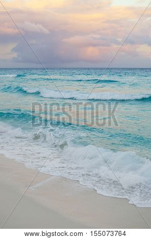 Seascape at pinkish sunset at the sea