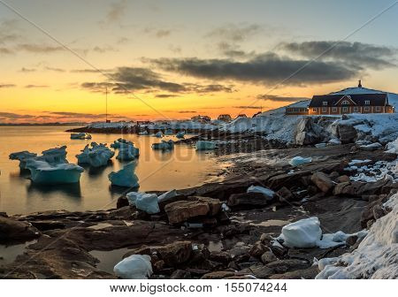 Nuuk city old harbor sunset view with icebergs Greenland